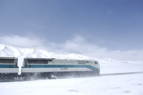 Tibet train along the snow mountain